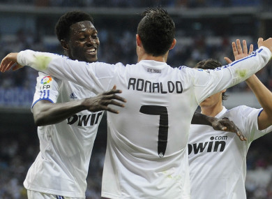 Ronaldo and Adebayor celebrate during their time together at Real Madrid.