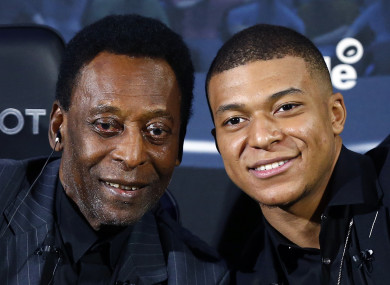 Pele and Mbappe pictured together during a photocall in Paris.