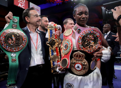 Claressa Shields holds her belts after defeating Christina Hammer by unanimous decision.