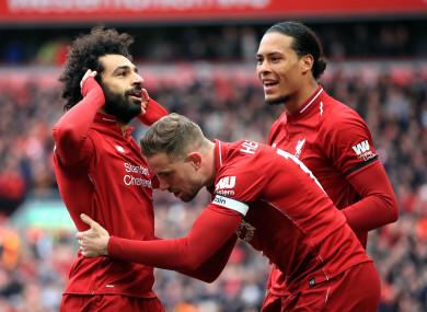 Mo Salah celebrates with Jordan Henderson and Virgil van Dijk.