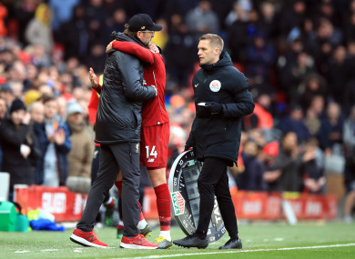 Klopp embraces Henderson after Liverpool's defeat of Chelsea on Sunday.