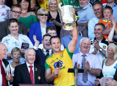 Michael Murphy lifts the trophy.