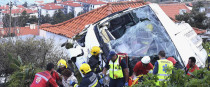 Emergency services attend the scene after a tour bus crashed at Canico, on Portugal's Madeira island.