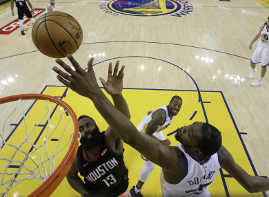Kevin Durant blocks a shot from James Harden.