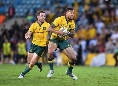 Israel Folau in possession during Australia's game against Argentina last September, as Bernard Foley looks on.