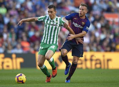 Lo Celso under pressure from Barcelona midfielder Arthur.