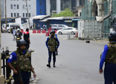 Soldiers stand guard for checkpoints in the street of Colombo earlier this week