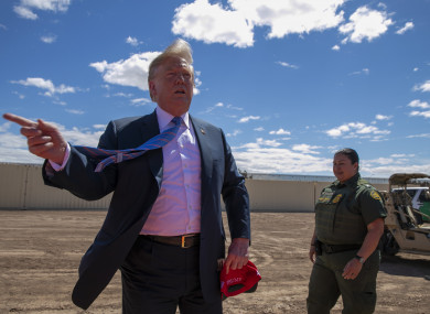 President Donald Trump speaks as he visits a new section of the border wall.