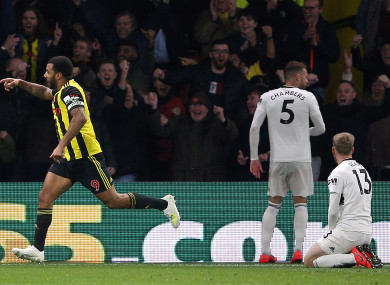 Fulham players watch on as Troy Deeney celebrates a goal for Watford.