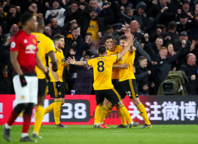 Wolves players celebrate Smalling's second half own goal.