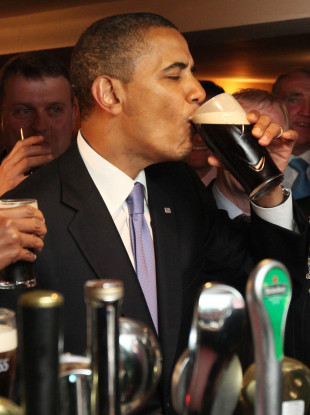 Barack Obama drinks a pint in his ancestral village of Moneygall in 2011