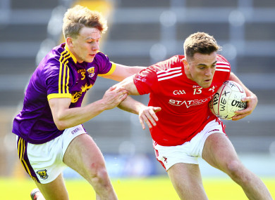 Louth's Andy McDonnell is tackled by Wexford's Martin O'Connor.