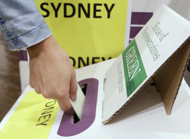 A voter casts their ballot at the Town Hall in Sydney.