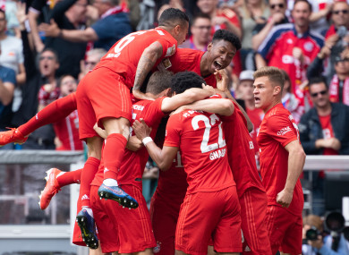Bayern's players mob Kingsley Coman after the game's opening goal.
