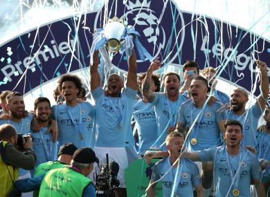 Manchester City's Vincent Kompany (centre) lifts the Premier League trophy.