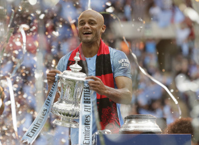 Vincent Kompany celebrates after yesterday's FA Cup final.