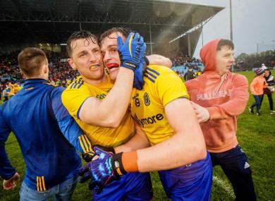 Roscommon players Diarmuid Murtagh and Enda Smith celebrate their win.