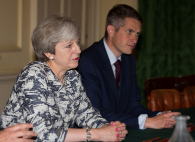 May with her former Defence Secretary.