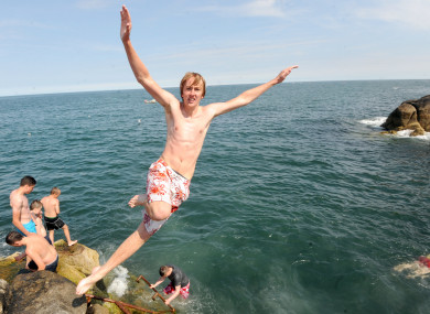 File photo of someone jumping in at the Forty Foot at Sandycove, Dublin.