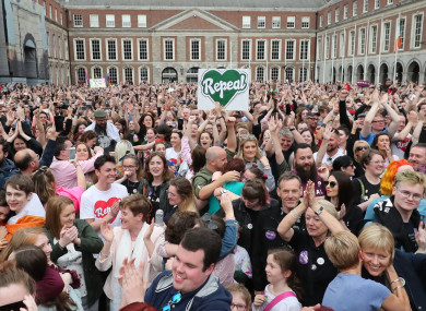 People celebrate in Dublin Castle as Ireland has voted to repeal the 8th Amendment