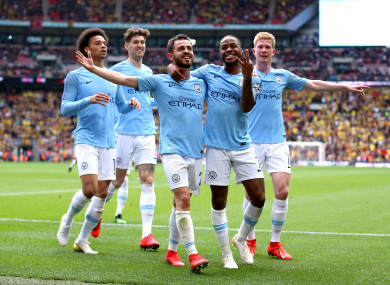 Raheem Sterling celebrates scoring his side's fifth goal at Wembley.