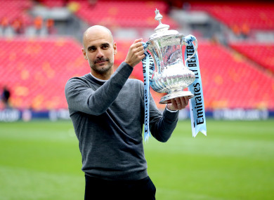 Guardiola holding the FA Cup at Wembley.