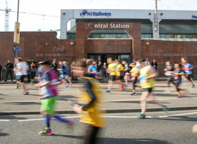 Runners pass Belfast Central Station. (File photo)