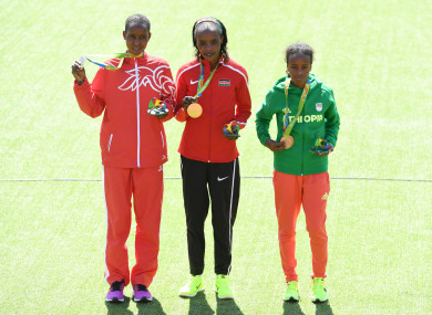 Eunice Jepkirui Kirwa (left) with her silver medal after the marathon at the Rio 2016 Olympic Games.