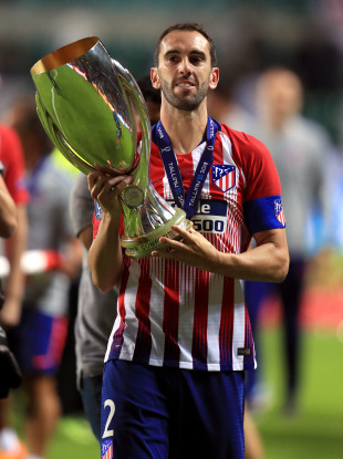 Diego Godin with the Uefa Super Cup trophy last year.