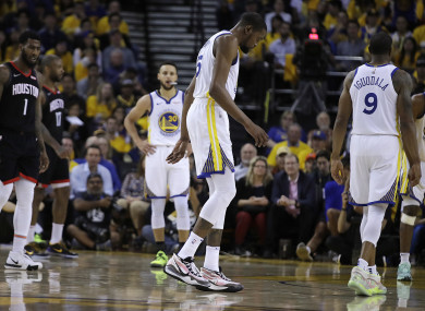 Kevin Durant limps off the court during Game 5 against the Houston Rockets.