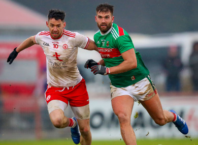 Mayo's Aidan O'Shea with Matthew Donnelly of Tyrone.