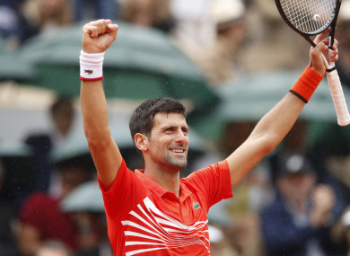Novak Djokovic celebrates after his fourth-round victory.