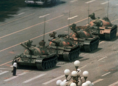 1989 photo of a Chinese man as he stands alone to block a line of tanks heading east on Beijing's Cangan Boulevard in Tiananmen Square .