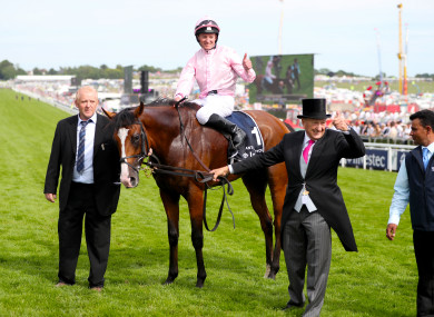 Jockey Seamie Heffernan celebrates winning the Investec Derby Stakes with Anthony Van Dyck
