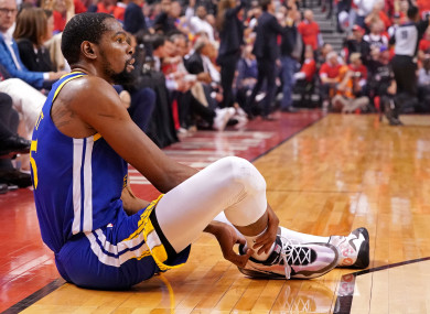 Kevin Durant holds his right Achilles during Game 5 of the NBA Finals.
