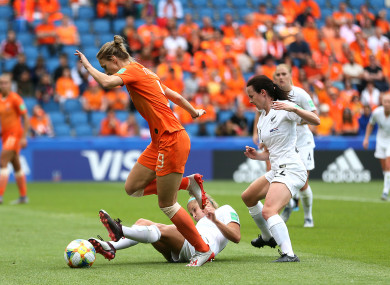 Netherland's Vivianne Miedema (left) and New Zealand's Rosie White (centre) battle for the ball.