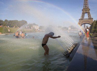 People cool off in ponds in Paris as France prepares for extreme temperatures.