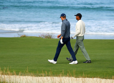 Jordan Spieth and Tiger Woods during a practice round at Pebble Beach.