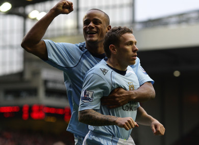 Kompany and Bellamy in action at Anfield in 2009.