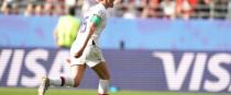 Megan Rapinoe celebrates her second-half penalty.