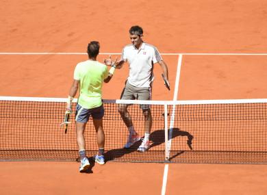 Nadal and Federer embrace in France.
