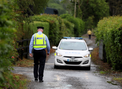 A member of An Garda near the scene in Belan, Moone, in Co. Kildare where two men have died following a light aircraft crash.