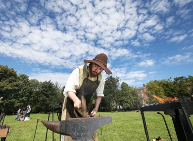 Blacksmith Owen Mort shows people how the shape metal as part of Heritage Week 2016.