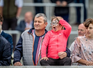 A young racegoer reacts as she watches the feature race of the day at the Curragh last Sunday.