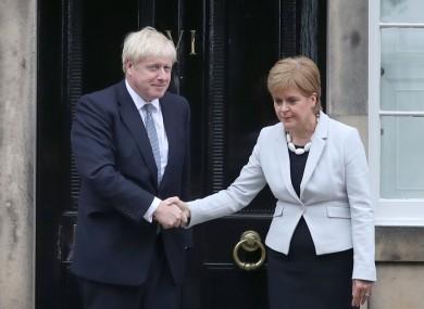 An awkward handshake between Scottish First Minister Nicola Sturgeon and British PM Boris Johnson.