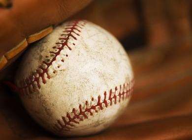 Close-up of a baseball in a glove.