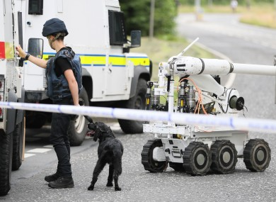 Ammunition technical officers near the scene in Tullygally Road, Craigavon, Co Armagh.
