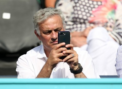 Jose on his phone.