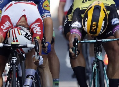 Australia's Caleb Ewan, left, and Netherlands' Dylan Groenewegen cross the finish line during the 11th stage of the Tour de France.
