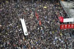 Protesters take part in a march in Hong Kong today.